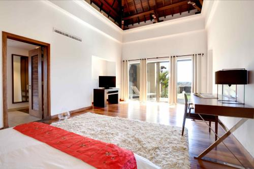 A television and/or entertainment center at Villa Solara by Oazure 1-8 persons