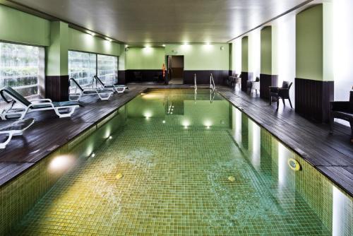 The swimming pool at or near Golden Tulip São João da Madeira Hotel