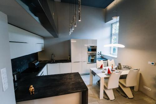 Kuchyňa alebo kuchynka v ubytovaní AH Luxury Baštová 10