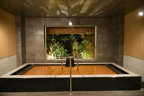 The swimming pool at or near Arima Onsen Taketoritei Maruyama
