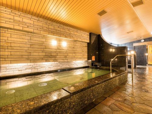 The swimming pool at or near APA Hotel Hiroshima-Ekimae Ohashi