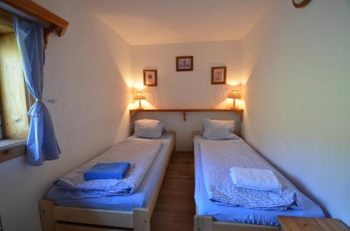 A bed or beds in a room at Penzion Lion