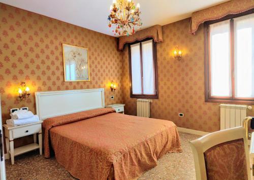Cama ou camas em um quarto em Ca' San Vio