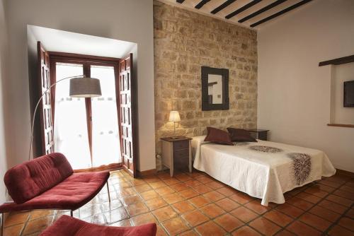 A bed or beds in a room at Alvaro de Torres Boutique