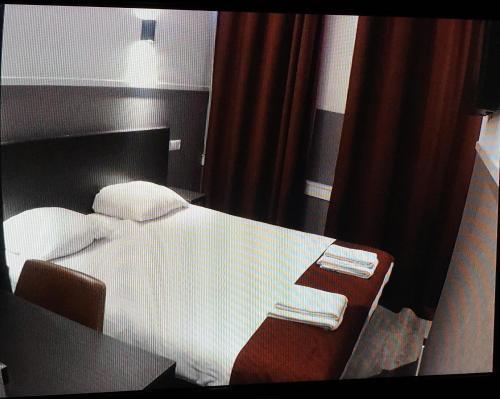 Cama ou camas em um quarto em Hotel Manofa