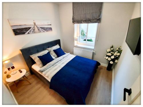 A bed or beds in a room at Rent Sopot Mariana Mokwy 20