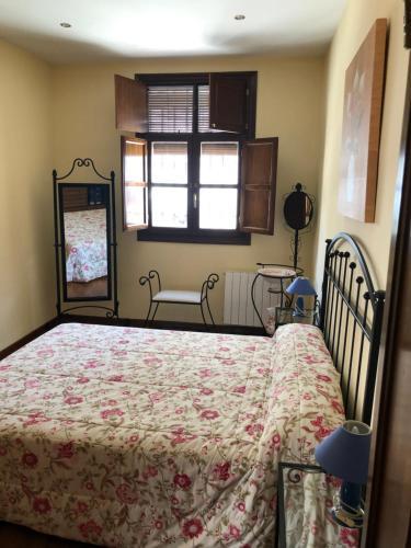 Cama o camas de una habitación en La casa de Tita Elvira 6