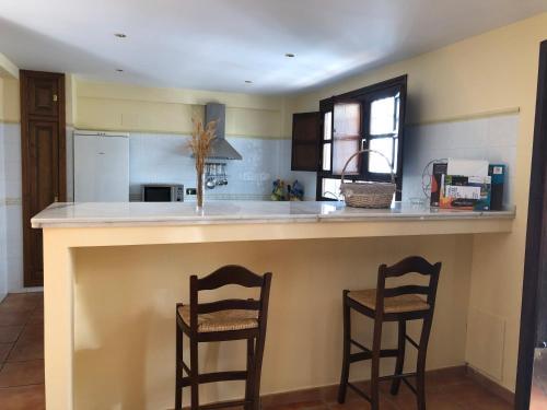 Una cocina o zona de cocina en La casa de Tita Elvira 6