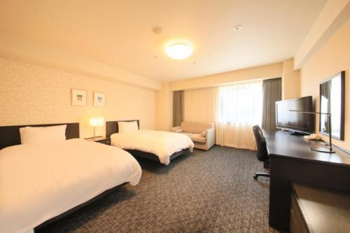 Кровать или кровати в номере Richmond Hotel Nagoya Nayabashi