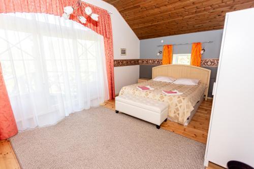 Voodi või voodid majutusasutuse Guest House Rannaliiv toas