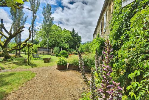 A garden outside Hotel La Maison des Peyrat