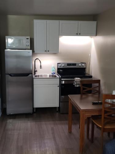 A kitchen or kitchenette at Homeward Inns of Canada