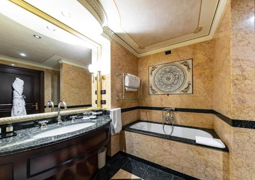 A bathroom at River Chateau Hotel
