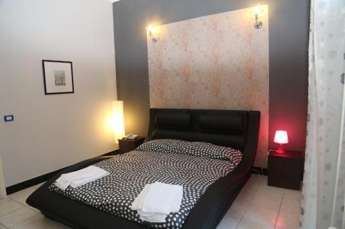 A bed or beds in a room at Nuovo Hotel Sangiuliano