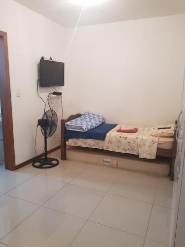 A seating area at Apartamento de apoio