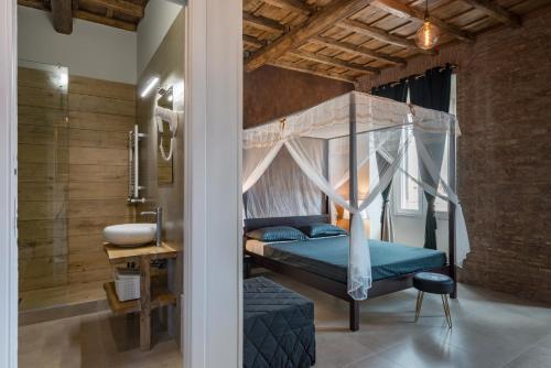 Letto o letti in una camera di Le Boutique Luxury Resort