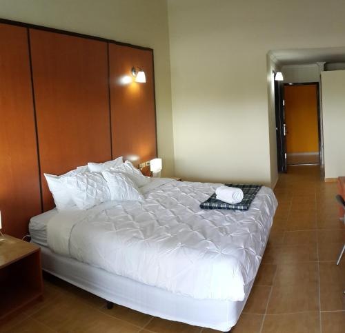 A bed or beds in a room at Express Inn Coronado & Camping