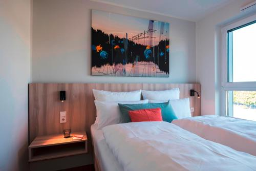 A bed or beds in a room at Mintrops Concierge Hotel
