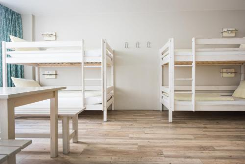 A bunk bed or bunk beds in a room at Wombat's The City Hostel Munich Hauptbahnhof
