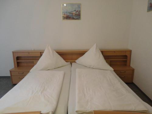 Ein Bett oder Betten in einem Zimmer der Unterkunft Gasthof Reif
