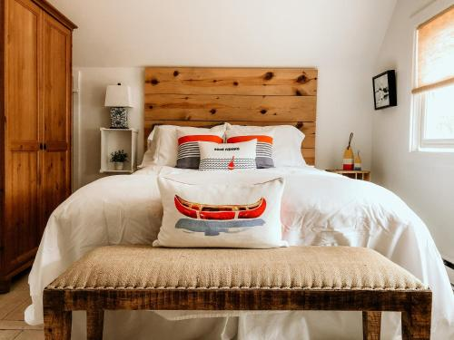 A bed or beds in a room at Over The Way Cottage