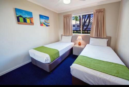 A bed or beds in a room at Gold Coast Family Apartment