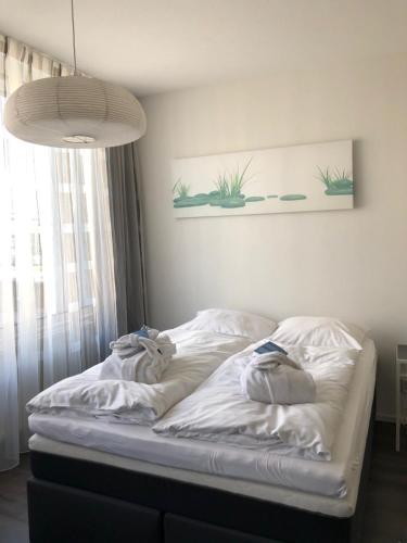 Een bed of bedden in een kamer bij De Overtoom 46