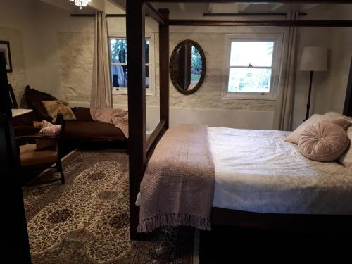 A bed or beds in a room at Tanilba House