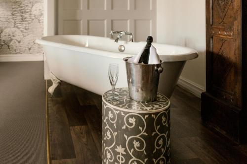 A bathroom at Stonehouse Court Hotel - A Bespoke Hotel