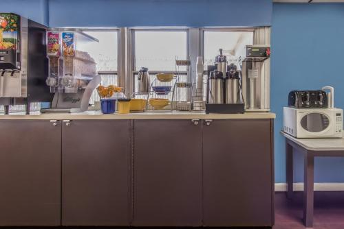 A kitchen or kitchenette at Days Inn by Wyndham Hicksville Long Island