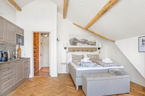 Un ou plusieurs lits dans un hébergement de l'établissement Sakrisøy Gjestegård