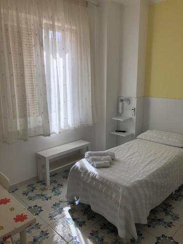 Cama ou camas em um quarto em Albergo Oasi
