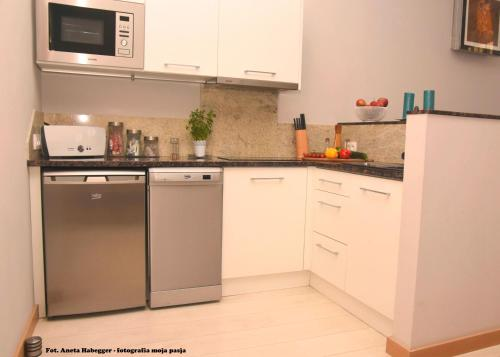A kitchen or kitchenette at Amber Apartments