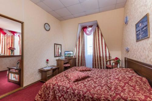 Кровать или кровати в номере Гостиница «Мирабель»