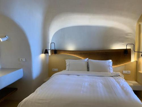 A bed or beds in a room at Chic Hotel Santorini