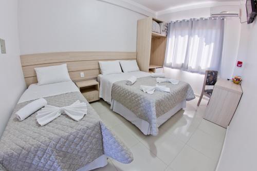 Cama ou camas em um quarto em North Hotel - O mais próximo do Aeroporto de Chapecó