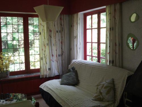 A bed or beds in a room at Marcinelle Apartotel Des Jardins De La Fontaine Qui Bout
