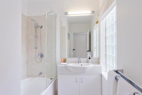 A bathroom at Offshore Noosa Resort