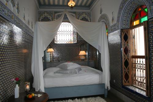 A bed or beds in a room at Dar Mayssane
