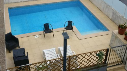 A view of the pool at Casa de Coelhosa or nearby