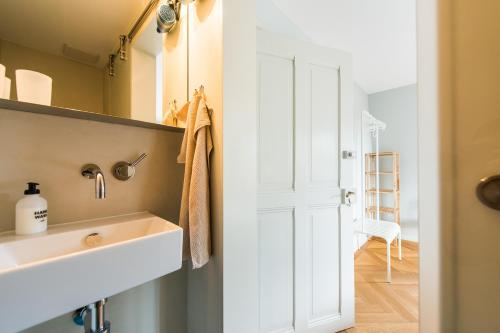 Ein Badezimmer in der Unterkunft B&B The B