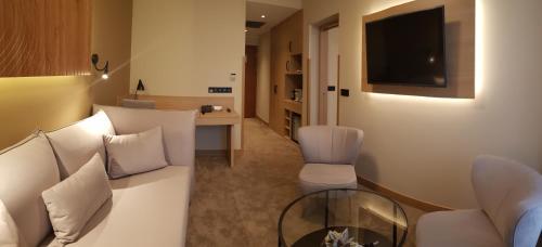 Ein Sitzbereich in der Unterkunft Hotel Clement