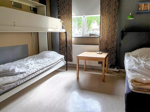 Kerrossänky tai kerrossänkyjä majoituspaikassa Svefi Vandrarhem - Hostel