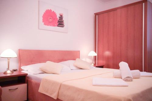 Postel nebo postele na pokoji v ubytování House Bilic
