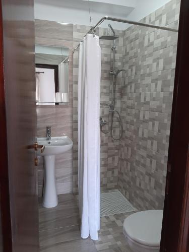 A bathroom at Mouria Hotel