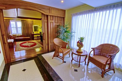 A seating area at Shwe Ingyinn Hotel Mandalay