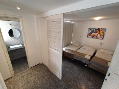 Cama ou camas em um quarto em Flat Atlântico Mobiliados