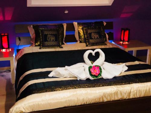 Een bed of bedden in een kamer bij B&B Kookhai