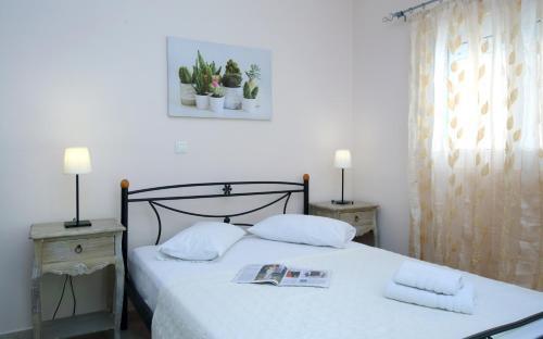 Ένα ή περισσότερα κρεβάτια σε δωμάτιο στο Apartments Avra