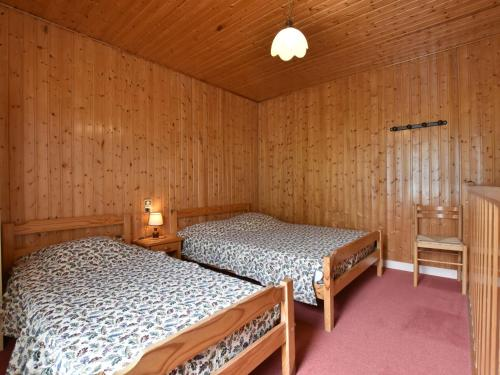 A bed or beds in a room at Cozy Apartment in La Bresse France near Ski Area